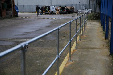 Work safety hand rails providing safe walking area