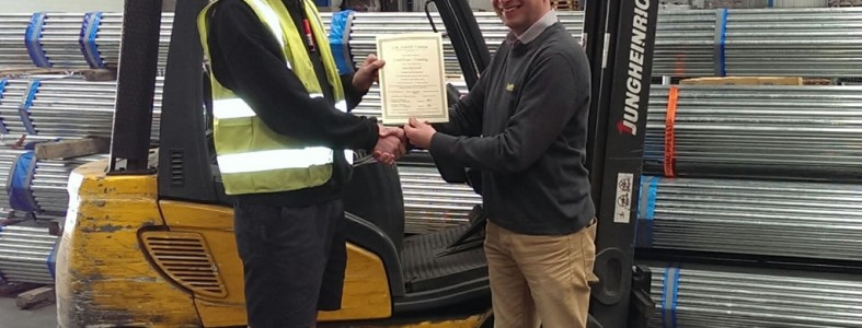 student passes his apprenticeship sat on a forklift