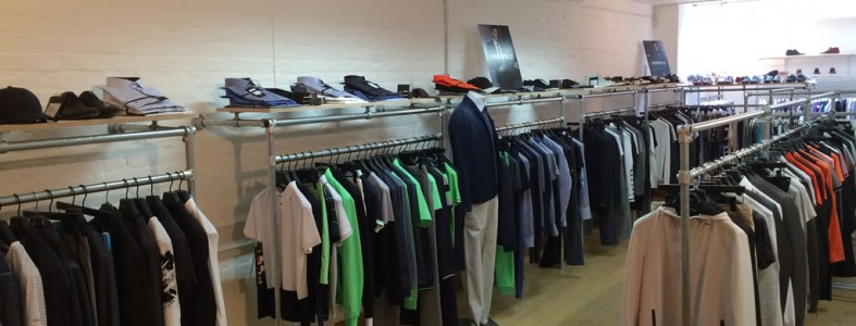 Multiple clothes hanger rails fitted into a shop floor